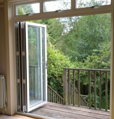 White bi-folding doors on balcony