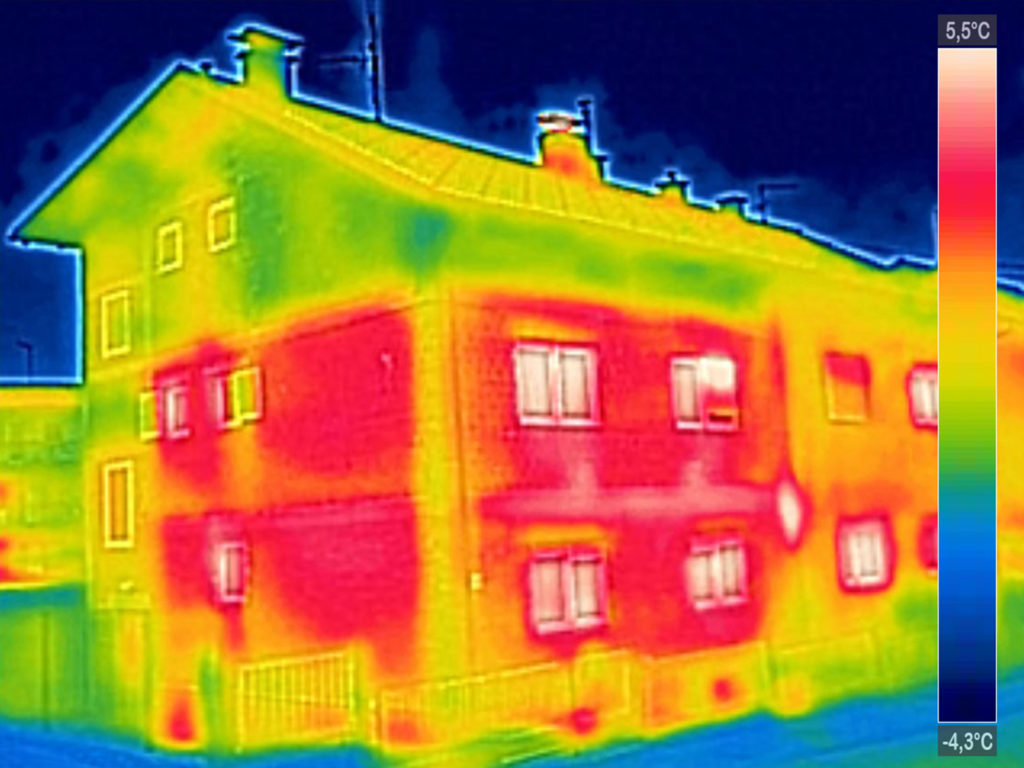 Infrared thermovision image showing lack of thermal insulation on House with or without facade